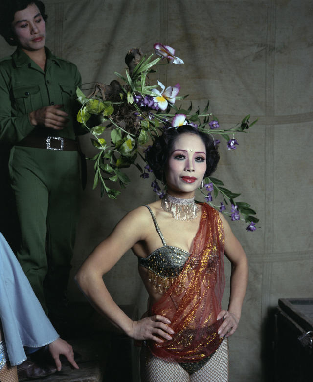 "<p>Circus performer, 1988. (© William E. Crawford from the book ""Hanoi Streets 1985-2015: In the Years of Forgetting"") </p>"