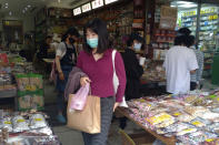 People wearing face masks to help curb the spread of the coronavirus shop at a market in Taipei, Taiwan, Monday, Oct. 19, 2020. (AP Photo/Chiang Ying-ying)