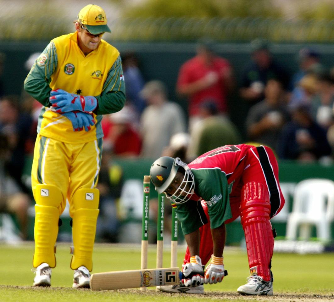 HOBART, AUSTRALIA:  Zimbabwean batsman Tatenda Taibu (R) stikes an unusual poses after missing the ball while Australian wicketkeeper Adam Gilchrist (L) looks on during their match played in Hobart, 16 January 2004.  Australia have scored 344-7 from their 50 overs and in reply Zimbabwe could only manage 196-6 from their 50 overs.  AFP PHOTO/William WEST  (Photo credit should read WILLIAM WEST/AFP/Getty Images)
