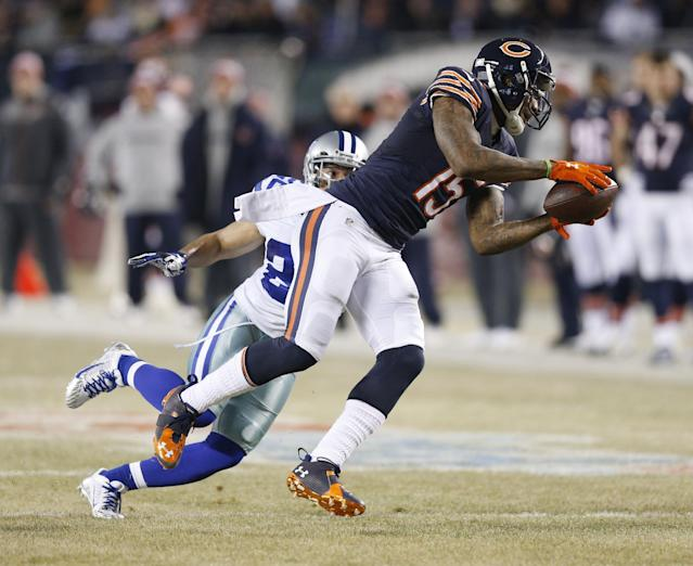 Brandon Marshall of the Chicago Bears catches a pass in front of Sterling Moore of the Dallas Cowboys during their game at Soldier Field on December 4, 2014 in Chicago, Illinois (AFP Photo/Joe Robbins)