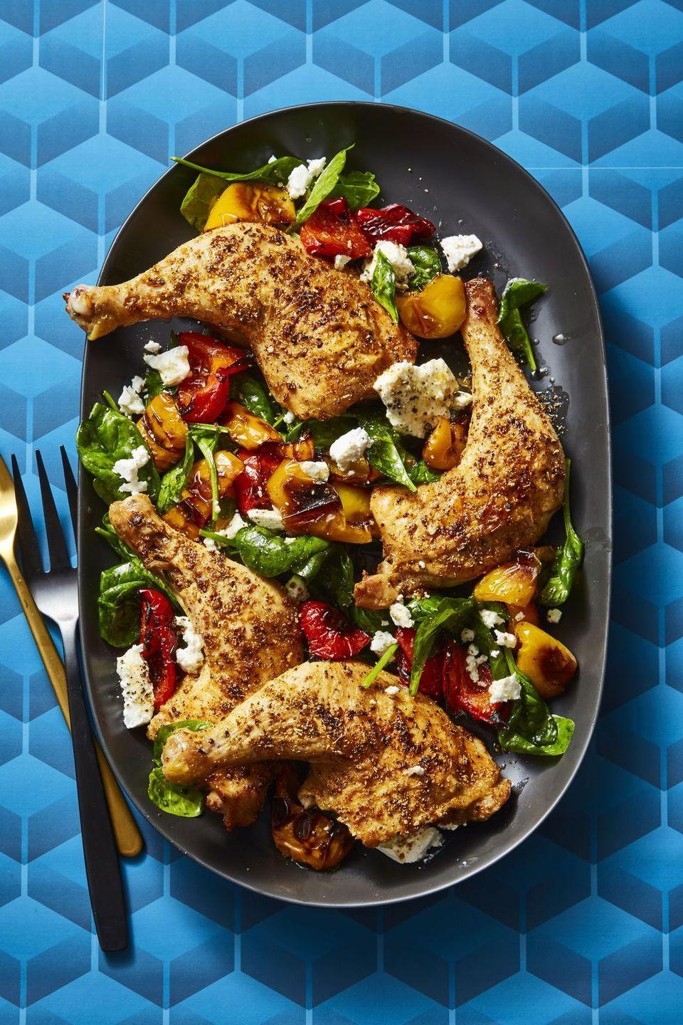 """<p>A bed of spinach and creamy feta play host to earthy roasted chicken legs.</p><p><em><a href=""""https://www.goodhousekeeping.com/food-recipes/easy/a25656846/fennel-roasted-chicken-and-peppers-recipe/"""" rel=""""nofollow noopener"""" target=""""_blank"""" data-ylk=""""slk:Get the recipe for Fennel Roasted Chicken and Peppers »"""" class=""""link rapid-noclick-resp"""">Get the recipe for Fennel Roasted Chicken and Peppers »</a></em></p>"""