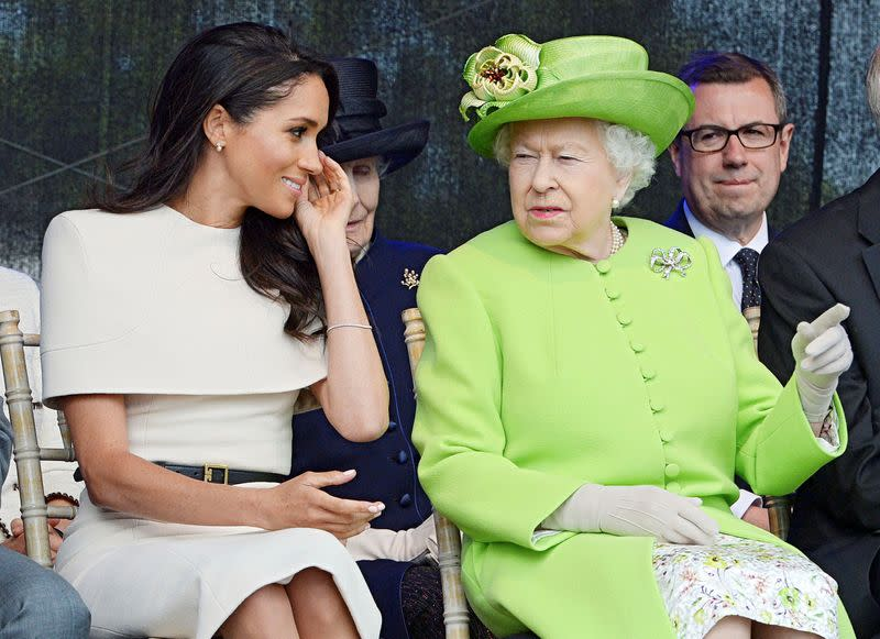 FILE PHOTO: Britain's Queen Elizabeth and Meghan The Duchess Of Sussex attend the opening of the Mersey Gateway Bridge in Runcorn