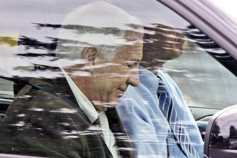 Former Penn State assistant football coach Jerry Sandusky, left, leaves with attorney Joe Amendola after jury selection was completed for Sandusky's trial on child sexual abuse charges, at the Centre County Courthouse in Bellefonte, Pa., Wednesday, June 6, 2012. (AP Photo/Gene J. Puskar)