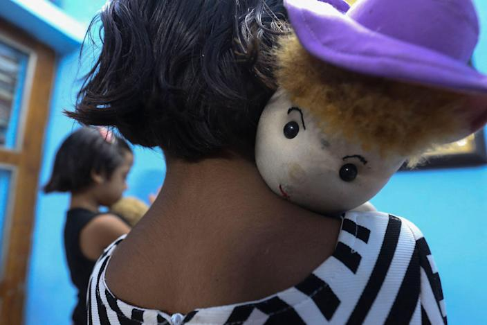 <p>One of the twin sisters Tripti and Pari, who lost both their parents due to the Covid-19 coronavirus in Bhopal, India </p> (AFP via Getty Images)