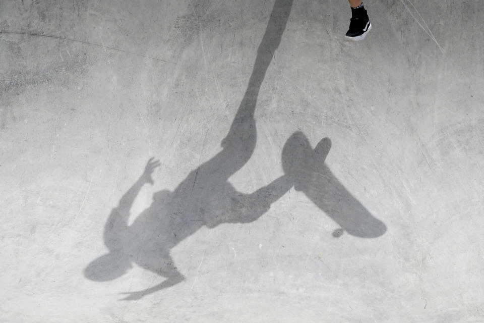 Hampus Winberg, of Sweden, practices during an Olympic qualifying skateboarding event at Lauridsen Skatepark, Wednesday, May 19, 2021, in Des Moines, Iowa. The questions under the magnifying glass at this week's Dew Tour — one of the last major qualifying events for the games in Tokyo in July — is whether the Olympics is ready for skateboarding and, more tellingly, whether skateboarding is ready for the Olympics. (AP Photo/Charlie Neibergall)