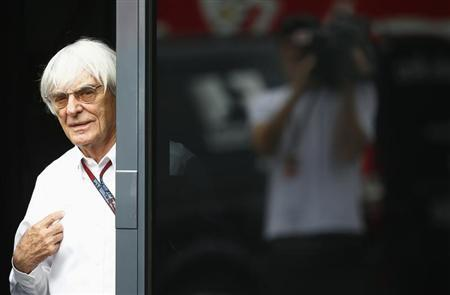 F1 commercial supremo Ecclestone looks out of his motor home after the second practice for the German F1 Grand Prix at the Nuerburgring racing circuit