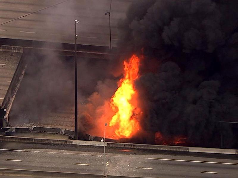 An aerial image from a video provided by WSB-TV showing a large fire that caused an overpass on Interstate 85 to collapse: AP