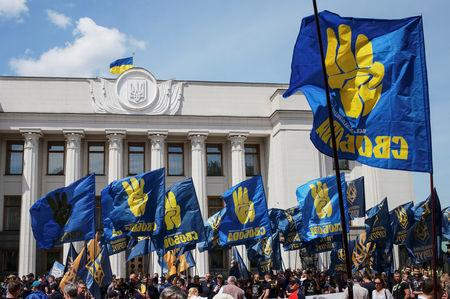 Activists of far-right parties attend a rally to demand lawmakers vote to change election law, in front of the parliament building in Kiev, Ukraine May 22, 2019.  REUTERS/Gleb Garanich
