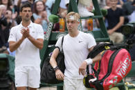 Canada's Denis Shapovalov leaves the court applauded by Serbia's Novak Djokovic at the end of the men's singles semifinals match on day eleven of the Wimbledon Tennis Championships in London, Friday, July 9, 2021. (AP Photo/Kirsty Wigglesworth)