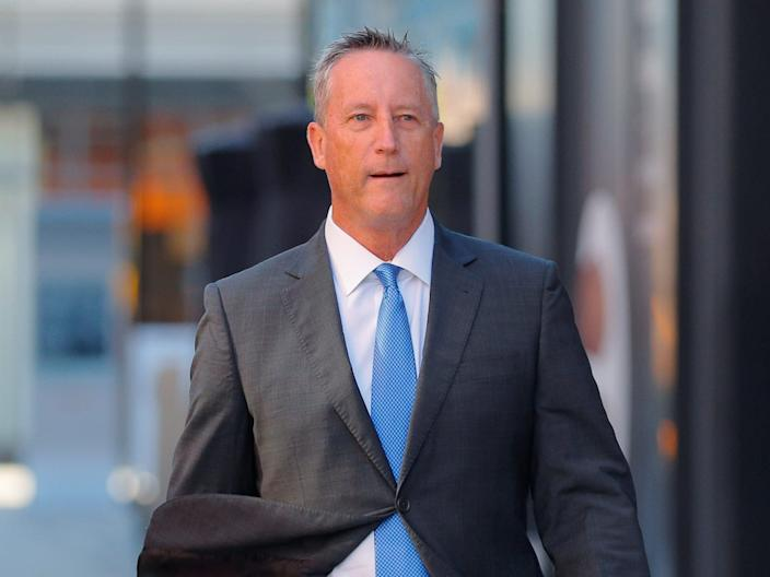 Martin Fox, a former president of a private tennis academy in Texas, passes the federal courthouse before entering a plea in a nationwide college admissions cheating scheme in Boston, Massachusetts, U.S., November 15, 2019..JPG