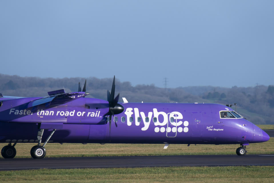 CARDIFF, WALES - JANUARY 18: A Flybe Bombardier DHC-8 Q400 aircraft at Cardiff Airport on January 18, 2020 in Cardiff, United Kingdom. British airline Flybe, who account for 36% of UK domestic flights, have struck a deal with the UK government to defer tax payments and have received increased funding from owners Connect Airways. The UK government also agreed to conduct an urgent review of Air Passenger Duty on domestic flights. (Photo by Matthew Horwood/Getty Images)