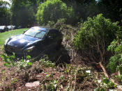 A car that was that was swept onto the banks of the Raritan River by the remnants of Tropical Storm Ida, remains in the area in Piscataway N.J, on Saturday, Sept. 4, 2021. (AP Photo/Wayne Parry)
