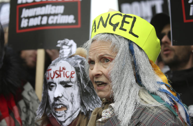 Fashion designer Vivienne Westwood joins supporters of Julian Assange, during a march from Australia House to Parliament Square in London, protesting the Wikileaks founder's imprisonment and extradition, Saturday Feb. 22, 2020. (Isabel Infantes/PA via AP)