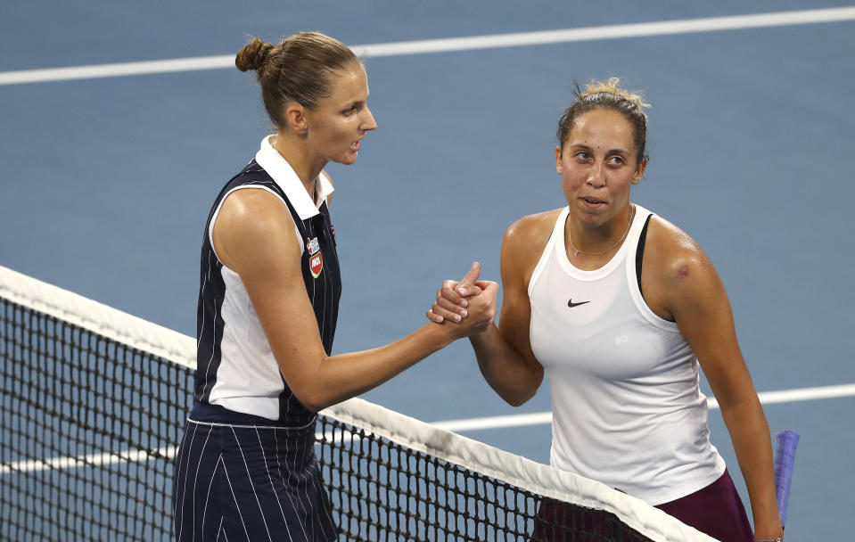 Karolina Pliskova of the Czech Republic, left, shakes hands with Madison Keys of the United States, right, after Pliskova won the match 6-4, 4-6, 7-5, at the Brisbane International tennis tournament in Brisbane, Australia, Sunday, Jan. 12, 2020. (AP Photo/Tertius Pickard)
