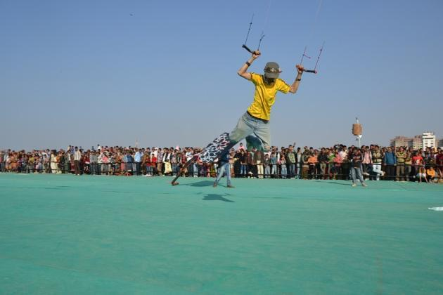 "A kite flyer tugs at strings in an attempt to be airborne  <br><br>Photo by Yahoo! reader <a target=""_blank"" href=""https://www.flickr.com/photos/61545942@N08/"">Nisarg Lakhmani</a>"
