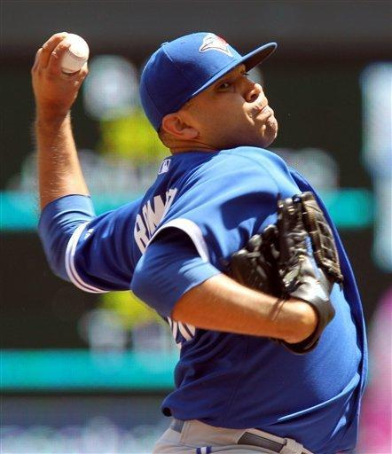 Toronto Blue Jays starting pitcher Ricky Romero throws against the Minnesota Twins during the first inning of a baseball game on Sunday, May 13, 2012, in Minneapolis. (AP Photo/Genevieve Ross)
