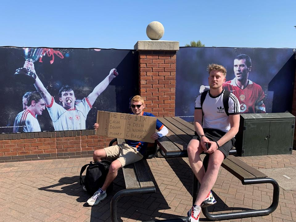 (Left) Jacob Ward, 21 and (Right) Dean Heslin, 30, football fans protesting outside Old Trafford against the European Super League (Gemma Bradley/PA)