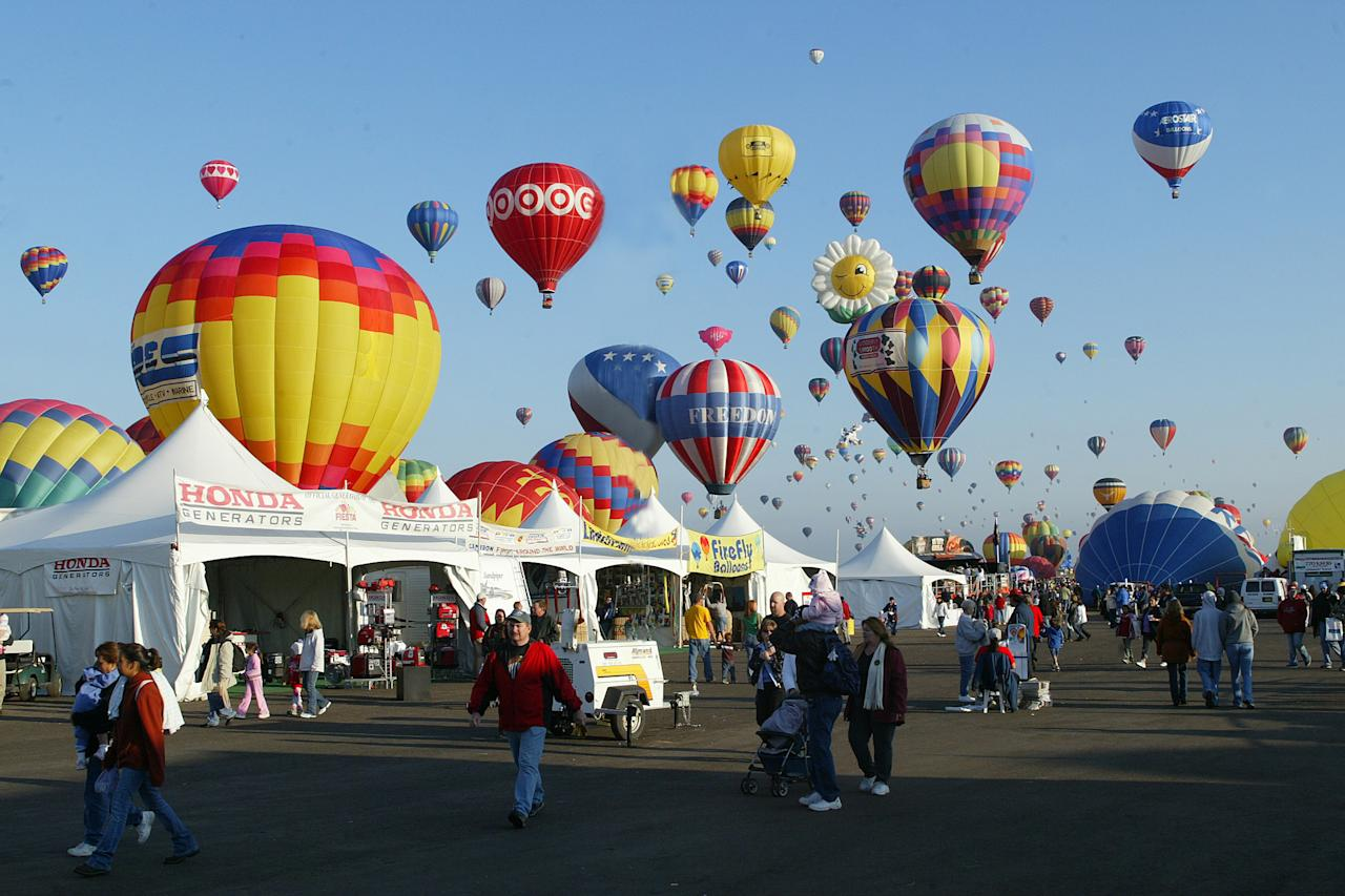 Balloons in flight at the Albuquerque International Balloon Fiesta at Albuquerque International Balloon Park in October 2005 in Albuquerque, New Mexico.   (Photo by Ronald C. Modra/Sports Imagery/Getty Images)