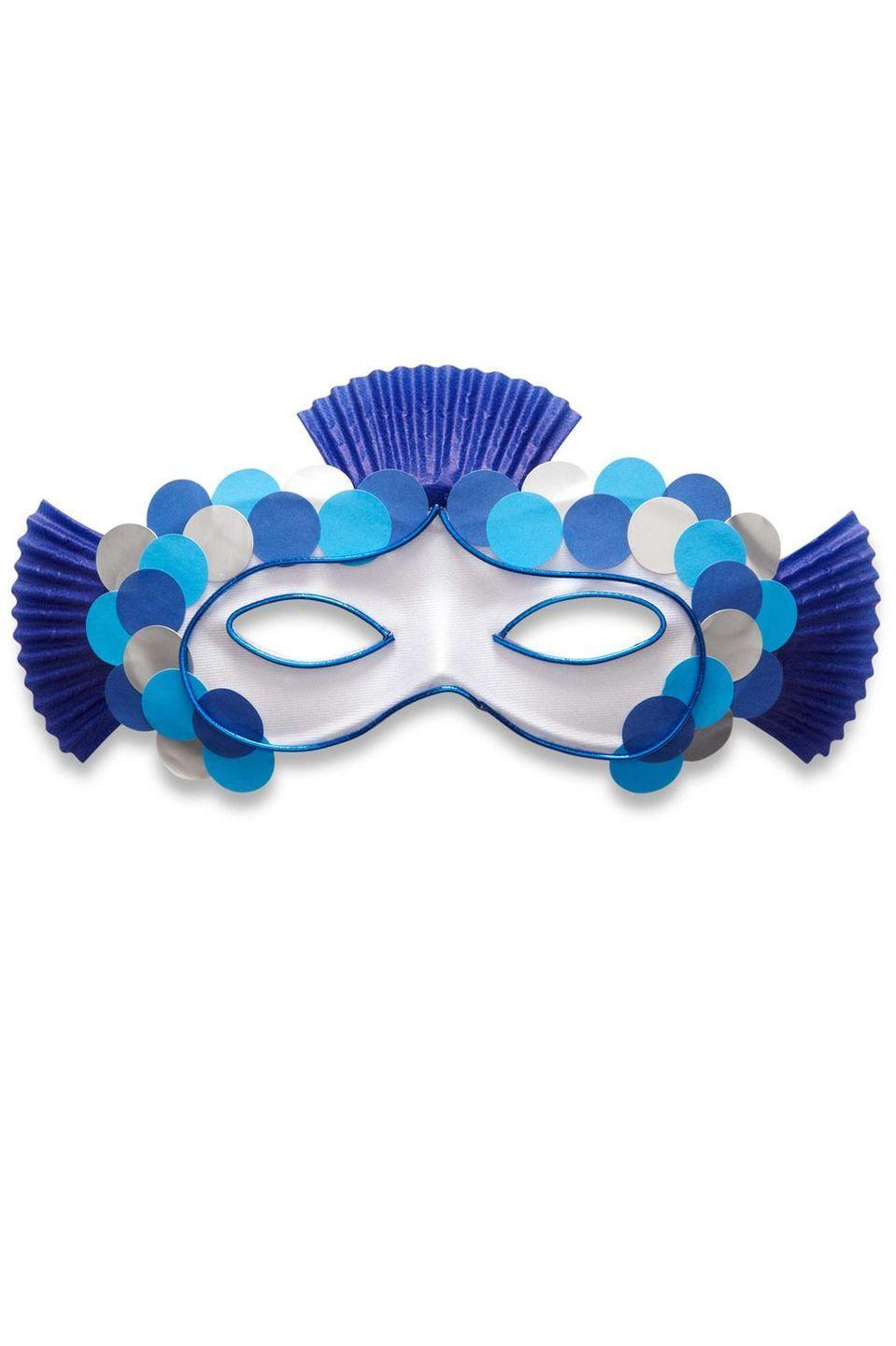 <p>Celebrate Halloween under the sea this year with this adorable fish mask. </p><p>1. Fold each cupcake liner in half horizontally. Hot-glue to the back of the mask in the top center and at the side of each eye as shown. Let set.</p><p>2. Beginning in the center and working your way to the side and then down, overlap office dots as shown.</p><p>3. Measure cord in a face shape, bringing it to a point in the middle of the eyes. Trim to size and adhere with hot glue. Let set. Repeat to outline each eye.</p>