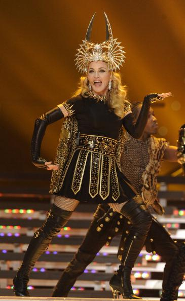 "<div class=""caption-credit""> Photo by: Getty Images</div><div class=""caption-title""></div><b>Performing at the 2012 Super Bowl Halftime Show in Indiana</b> <br> Millions of people tuned in to watch her shimmy and flip around the stage in a Cleopatra-inspired ensemble. She's still got it!"