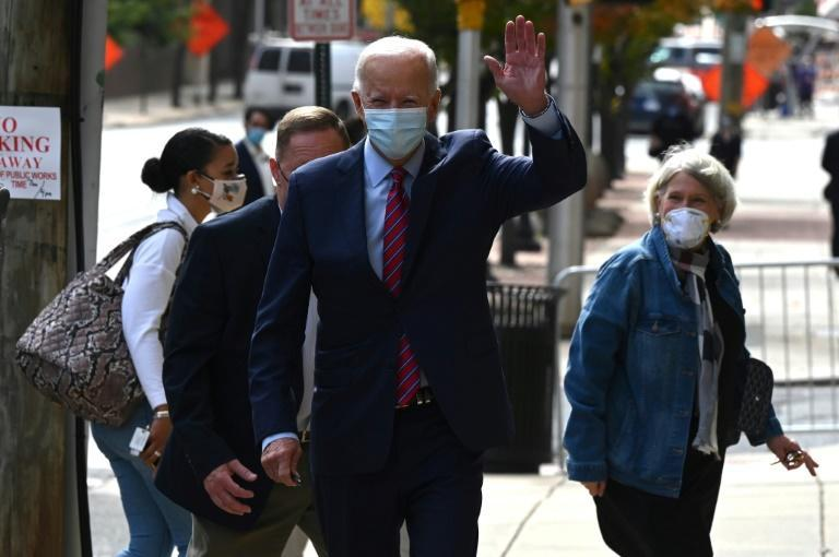 Democratic presidential candidate Joe Biden is much less visible but leads President Donald Trump in most polls