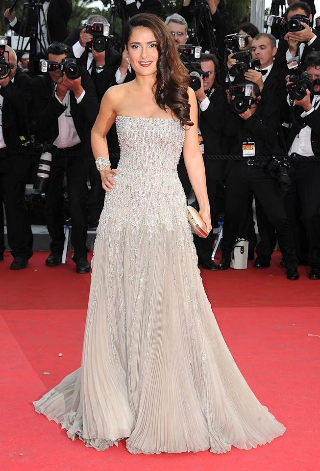 """Following in Uma's footsteps was the equally gorgeous Salma Hayek, who dropped jaws in a strapless Gucci Couture gown, which featured a crystal-encrusted bustier and pleated skirt. Side-swept hair, elegant earrings, and a pearl-adorned cuff completed the actress' amazing look. Dominique Charriau/<a href=""""http://www.wireimage.com"""" target=""""new"""">WireImage.com</a> - May 11, 2011"""