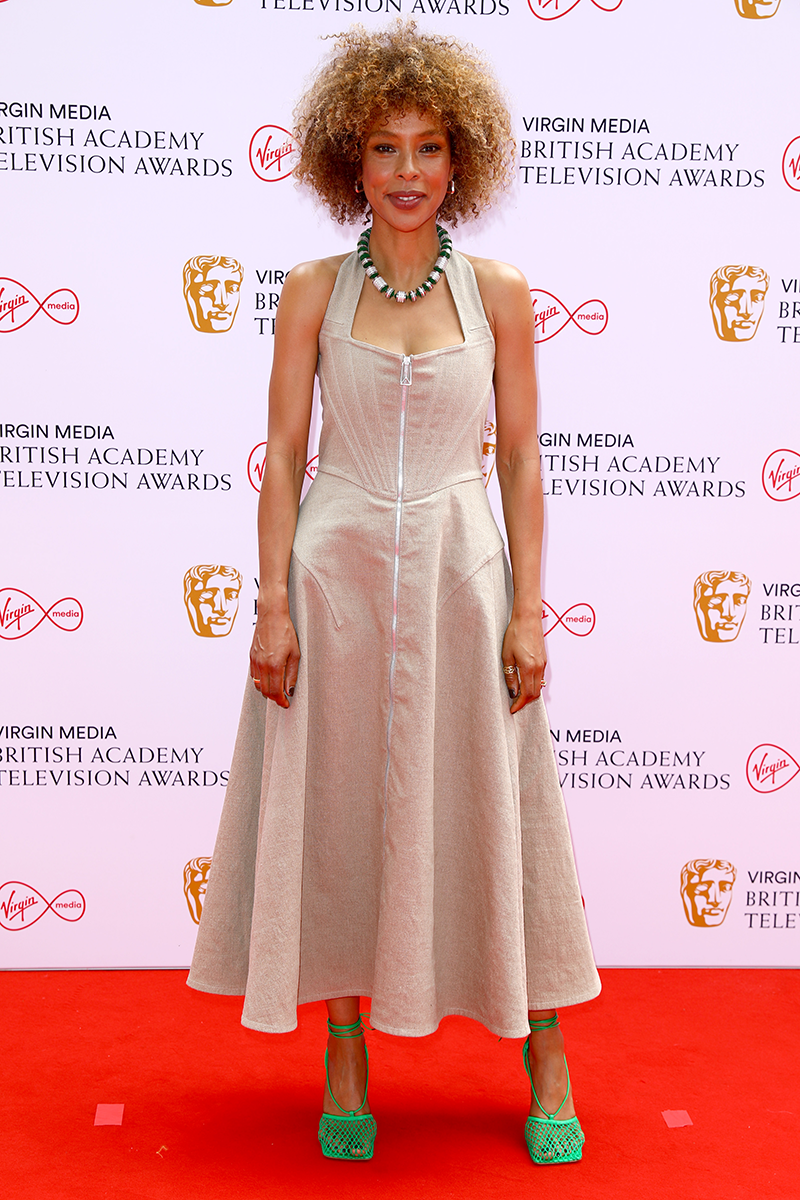 <p>Sophie Okonedo goes for a corset-like bodice and full skirt, offset with fresh green accessories.</p>
