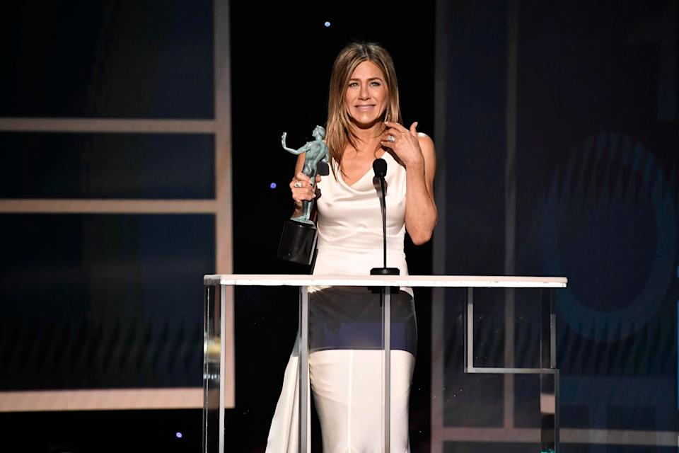 """Jennifer Aniston accepts the award for outstanding performance by a female actor in a drama series for her role as Alex Levy in """"The Morning Show"""" during the 26th Annual Screen Actors Guild Awards."""