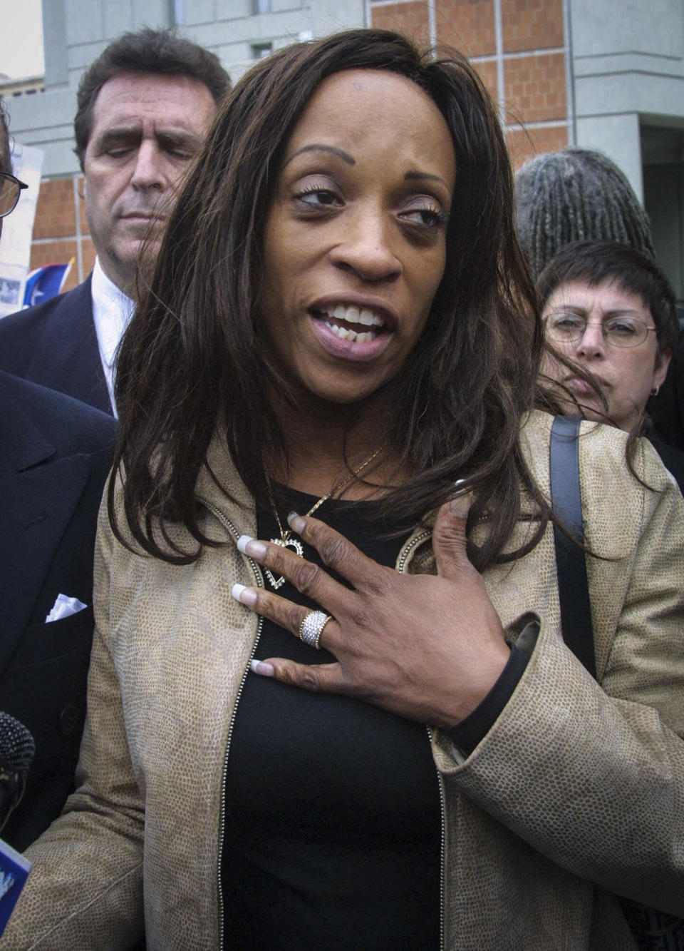 FILE - This Saturday May 26, 2001 file photo shows Kathy Jordan Sharpton as she meets with supporters following a visit to her husband the Rev. Al Sharpton at the Metropolitan Detention Center in the Brooklyn, N.Y. More than 16 years after separating, Rev. Al Sharpton has filed for divorce from his estranged wife, Kathy Jordan Sharpton. (AP Photo/Shawn Baldwin, File)