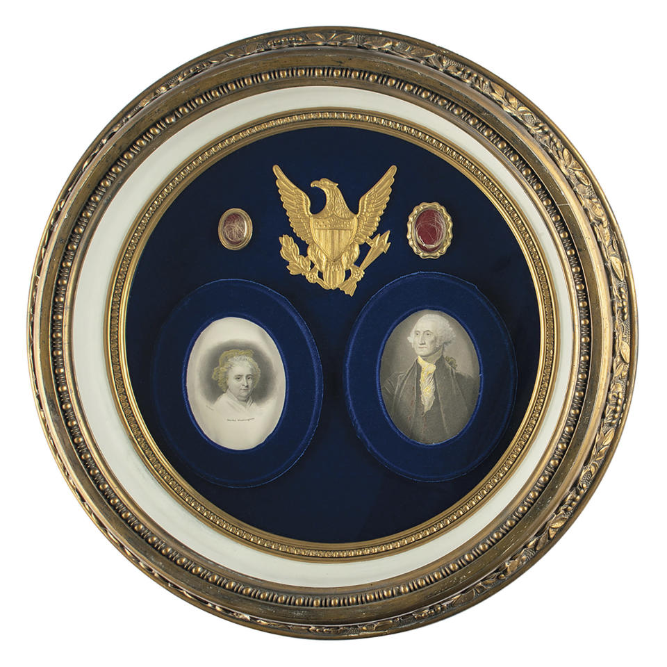 This undated photo released by RR Auction shows a shadowbox display featuring locks of hair from the heads of the first United States President George Washington, top right, and from his wife Martha, top left, up for auction between Feb. 11-18, 2021, by the Boston-based auction firm. (Nikki Brickett/RR Auction via AP)