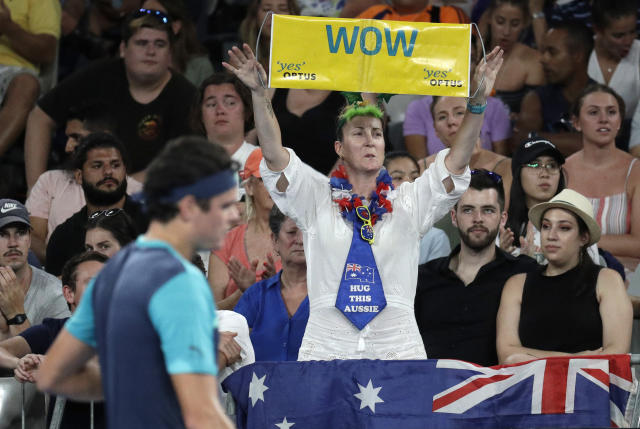 A supporter of Australia's Nick Kyrgios holds up a banner of support during his first round match against Canada's Milos Raonic at the Australian Open tennis championships in Melbourne, Australia, Tuesday, Jan. 15, 2019. (AP Photo/Aaron Favila)
