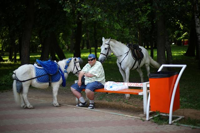 A man rent horses at a park in Nizhny Novgorod, Russia, June 23, 2018. As well as shooting all the matches, Reuters photographers are producing pictures showing their own quirky view from the sidelines of the World Cup. REUTERS/Ivan Alvarado