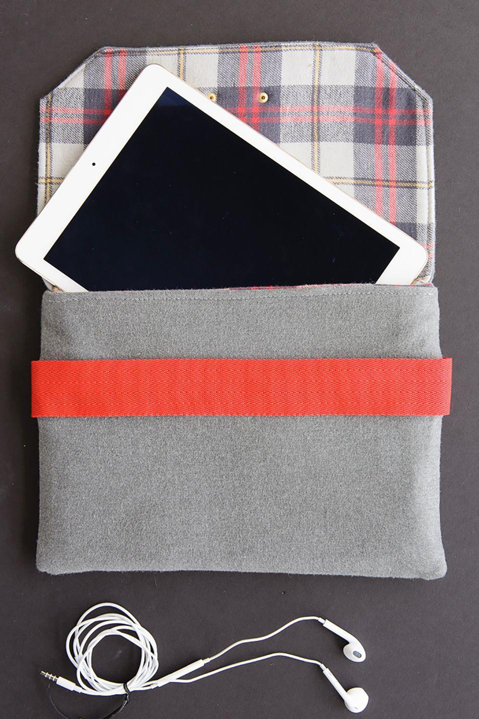 """<p>If you enjoy sewing, this wool case makes a wonderful gift for dads who often travel with their iPad. A nifty back pocket allows for storage of other small items like keys or headphones.</p><p><strong>Get the tutorial at <a href=""""http://www.polkadotchair.com/2015/06/wool-ipad-case-sewing-pattern.html/#_a5y_p=4515461"""" rel=""""nofollow noopener"""" target=""""_blank"""" data-ylk=""""slk:Polka Dot Chair"""" class=""""link rapid-noclick-resp"""">Polka Dot Chair</a></strong>. </p>"""