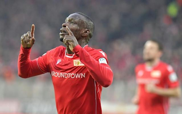 Nigerian Anthony Ujah celebrates putting Union Berlin ahead in a shock 2-0 triumph over Bundesliga leaders Borussia Moenchengladbach (AFP Photo/Tobias SCHWARZ)