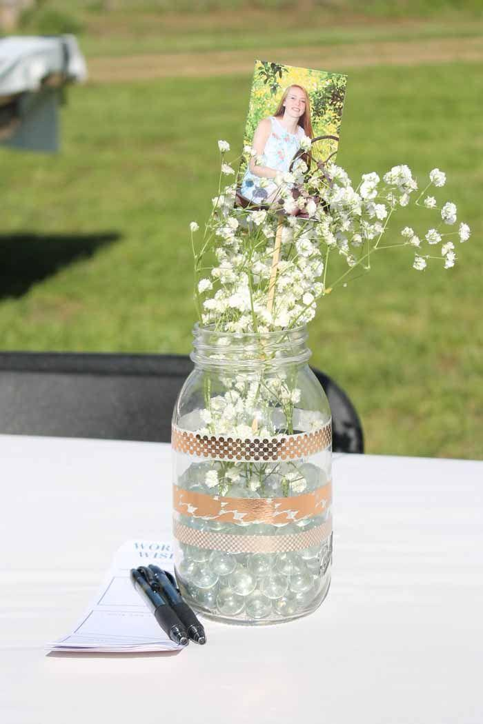 "<p>With photos attached to skewers and sprigs of baby's breath, you can create centerpieces for the graduation party that are sure to be memorable.</p><p><strong>Get the tutorial at <a href=""https://www.thecountrychiccottage.net/high-school-graduation-party-ideas/"" rel=""nofollow noopener"" target=""_blank"" data-ylk=""slk:Angie Holden/The Country Chic Cottage"" class=""link rapid-noclick-resp"">Angie Holden/The Country Chic Cottage</a>.</strong></p><p><a class=""link rapid-noclick-resp"" href=""https://go.redirectingat.com?id=74968X1596630&url=https%3A%2F%2Fwww.walmart.com%2Fip%2FRose-Gold-Washi-Tape-Supplies-Multipurpose-Projects-5-Rolls%2F244125218&sref=https%3A%2F%2Fwww.thepioneerwoman.com%2Fhome-lifestyle%2Fentertaining%2Fg36014713%2Fgraduation-party-ideas%2F"" rel=""nofollow noopener"" target=""_blank"" data-ylk=""slk:SHOP WASHI TAPE"">SHOP WASHI TAPE</a></p>"