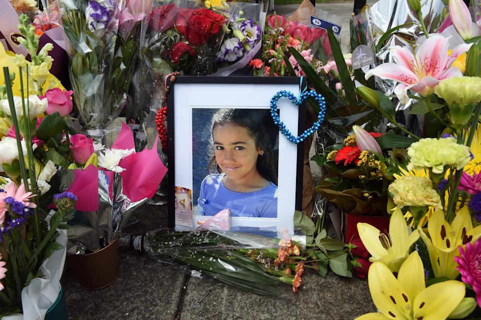 A floral tribute to Tia Palmer at the gates of Marsden State High School in Logan, Brisbane. Source: AAP
