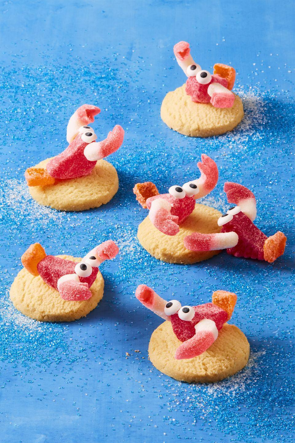 """<p>So candy and cookies might not be the healthiest of after-school snacks, but these cute crustacean cookies <em>are</em> a super-fun project <em>and </em>treat in one.</p><p><a href=""""https://www.womansday.com/food-recipes/food-drinks/recipes/a59000/gummy-lobsters-recipe/"""" rel=""""nofollow noopener"""" target=""""_blank"""" data-ylk=""""slk:Get the Gummy Lobsters recipe."""" class=""""link rapid-noclick-resp""""><em>Get the Gummy Lobsters recipe.</em></a></p>"""