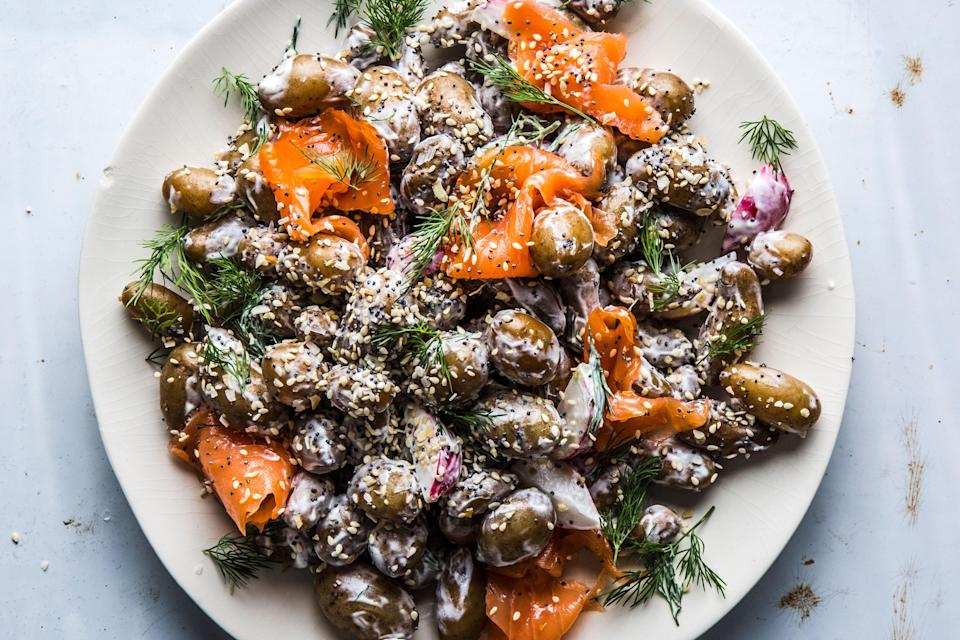 """A riff on a bagel with lox and cream cheese—but make it potato salad. If you're not feeling the smoked salmon, simply omit it. And if your market stocks jarred everything spice, use that in place of the homemade mix we've offered here. <a href=""""https://www.bonappetit.com/recipe/potato-salad-smoked-salmon-everything-bagel-spice?mbid=synd_yahoo_rss"""" rel=""""nofollow noopener"""" target=""""_blank"""" data-ylk=""""slk:See recipe."""" class=""""link rapid-noclick-resp"""">See recipe.</a>"""