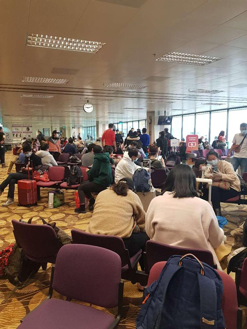 Upon arrival from Wuhan, 174 Singaporeans and their family members awaiting processing and quarantine at Changi Airport on the morning of Sunday, 9 February 2020. PHOTO: Qu Haiyan