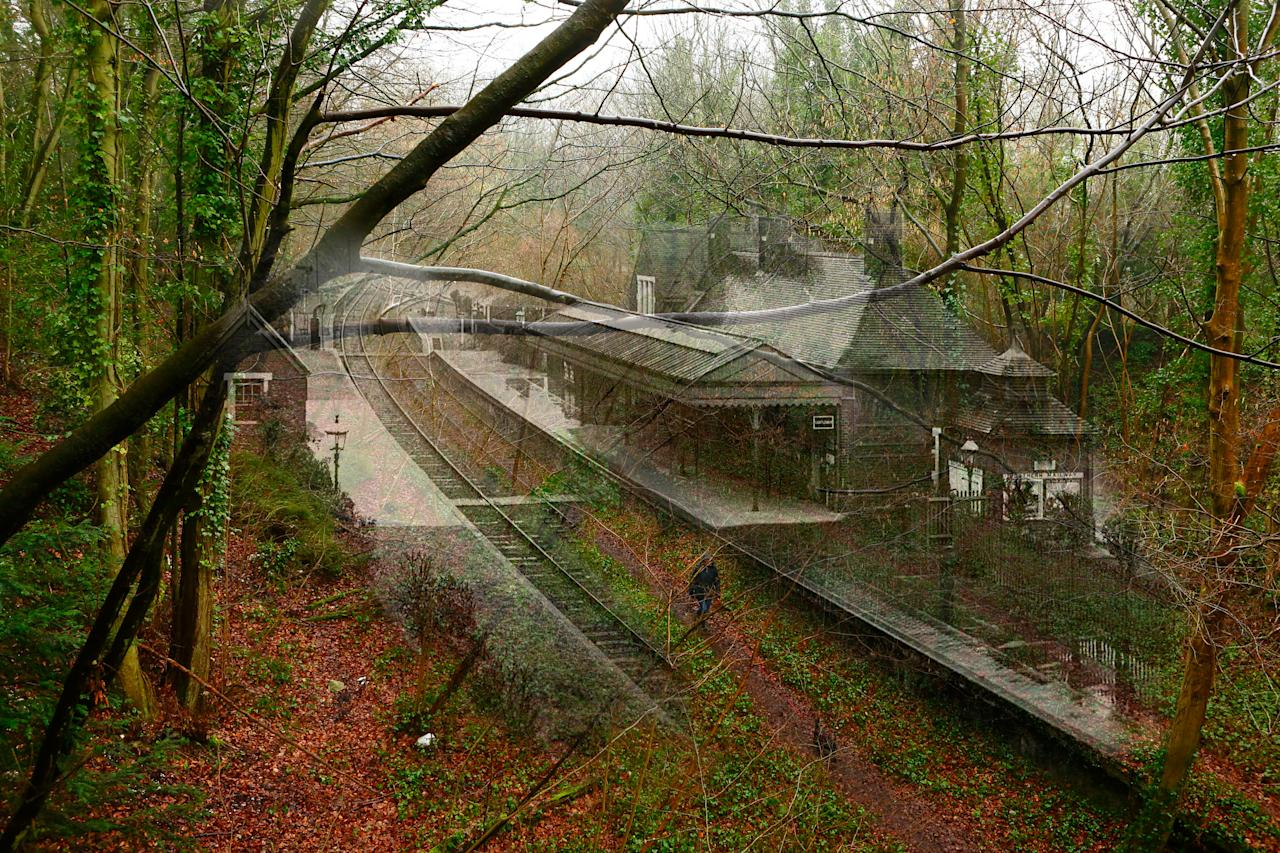 A ghostly composite combining old scenes with new shows a dog walker strolling along a footpath between the platforms of the shut-down former train station at West Meon in Hampshire.