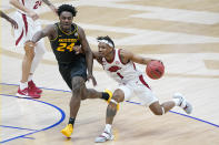 Arkansas' JD Notae (1) drives against Missouri's Kobe Brown (24) in the first half of an NCAA college basketball game in the Southeastern Conference Tournament Friday, March 12, 2021, in Nashville, Tenn. (AP Photo/Mark Humphrey)