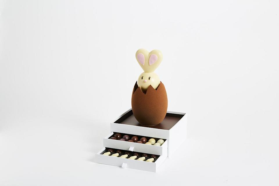 "<p>Say hello to the centrepiece of Pierre Marcolin's 2021 Easter collection. This dark chocolate egg rests on two drawers stuffed with small, crunchy praline caramel eggs and bells. The best part is that it will remain fresh and delicious for a good three months once opened, so you can enjoy it long after the Easter weekend (although you wouldn't be blamed for devouring it all in one, either). </p><p>£139 (<a href=""http://eu.marcolini.com/"" rel=""nofollow noopener"" target=""_blank"" data-ylk=""slk:in-store collection only"" class=""link rapid-noclick-resp"">in-store collection only</a>), Pierre Marcolini.</p>"