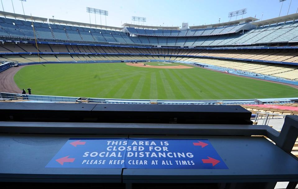Signs are posted around the stadium as the Dodgers prepare for opening day at Dodger Stadium.