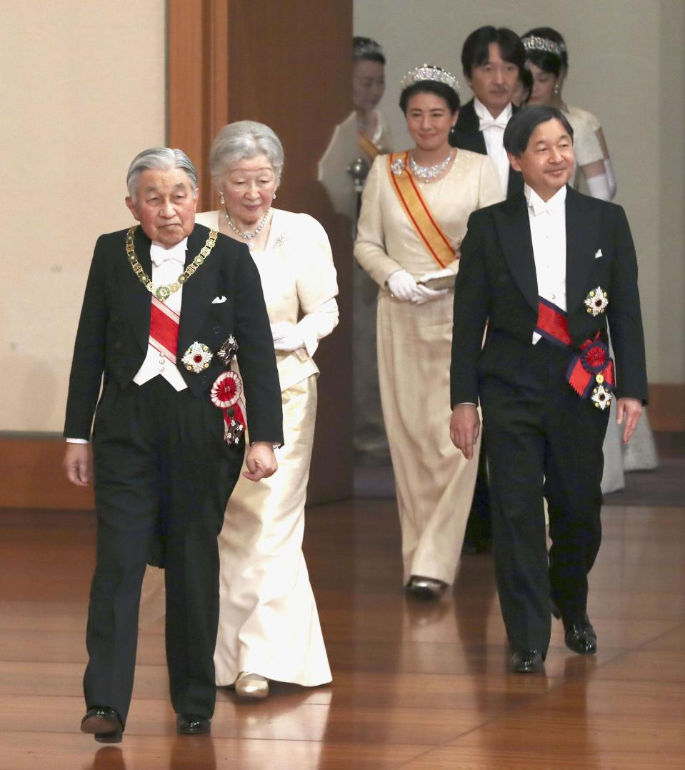 Japanese Emperor Akihito, left, and Empress Michiko, second from left, Crown Prince Naruhito, right, and Crown Princess Masako, second from right, arrive for an imperial ceremony in the celebration of New Year at the Imperial Palace in Tokyo, Tuesday. Jan. 1, 2019. (Kyodo News via AP)