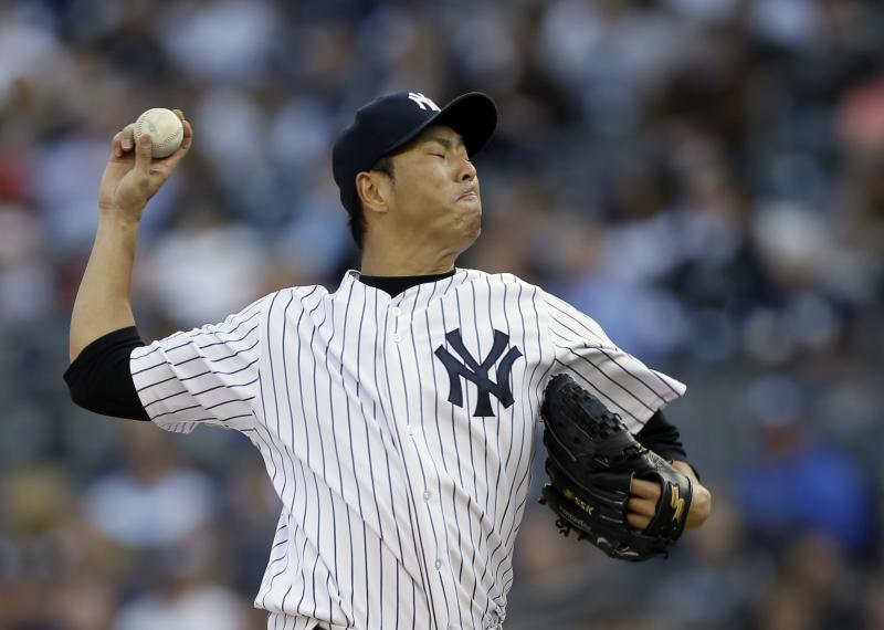 New York Yankees' pitcher Hiroki Kuroda throws in the first inning of Game 2 of the American League championship series between the Yankees and the Detroit Tigers Sunday, Oct. 14, 2012, in New York.  (AP Photo/Matt Slocum)