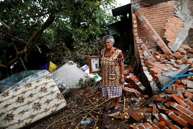 "<p>Maria Guzman, 70, a housewife, poses for a portrait on the rubble of her house after an earthquake in San Jose Platanar, at the epicentre zone, Mexico, September 28, 2017. The house was badly damaged, but with the help of her family Guzman rescued some furniture. She lives in a shelter and hopes her home will be rebuilt. ""The most valuable thing that I recovered was the photo of my wedding day,"" Guzman said. (Photo: Edgard Garrido/Reuters) </p>"
