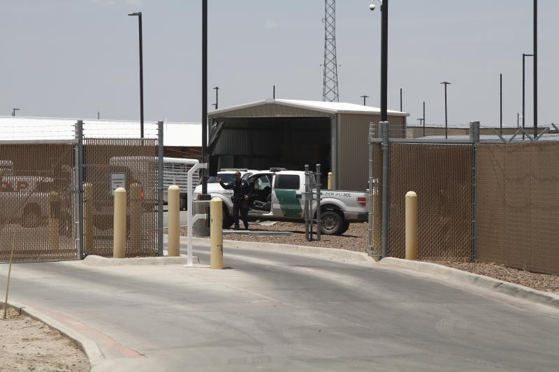 A Customs and Border Patrol officer guards the entrance to the Border Patrol station in Clint, Texas, Wednesday, June 26, 2019. The facility has been a hub for detained children in border patrol custody in New Mexico and West Texas since 2014. (AP Photo/Cedar Attanasio)