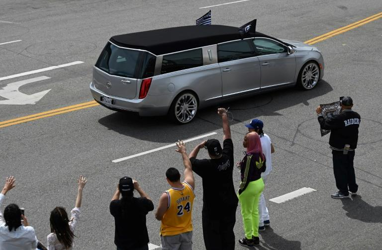 """The hearse carrying the remains of Nipsey Hussle leaves the Staples Center on a procession through Los Angeles after a """"Celebration of Life"""" memorial service for the rapper and social activist"""