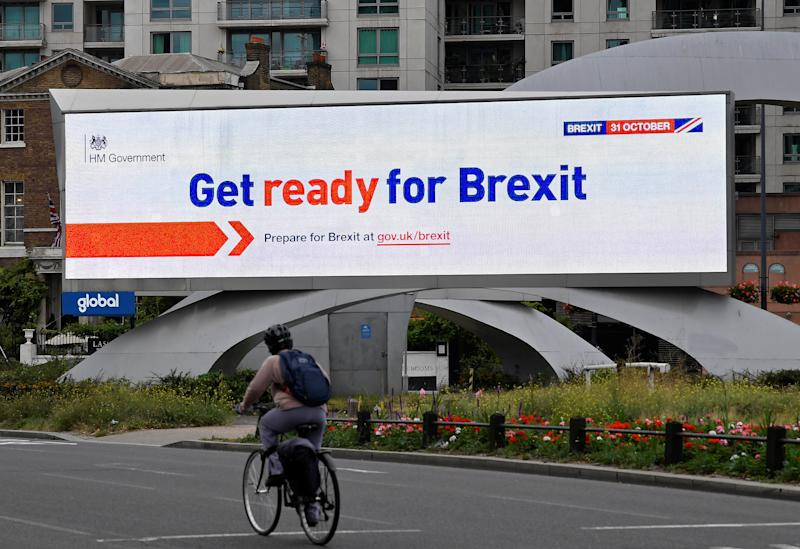 A cyclist rides past an electronic billboard displaying a British government Brexit information awareness campaign advertisement in London, Britain, September 11, 2019. REUTERS/Toby Melville.