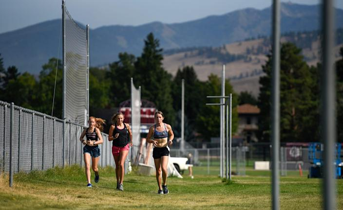 June Eastwood, right, competed for the University of Montana's men's track and cross country teams from 2016 to 2018 before transitioning.